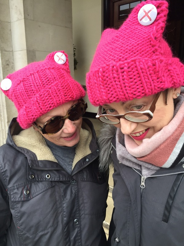 two women at the dublin march wearing pussyhats